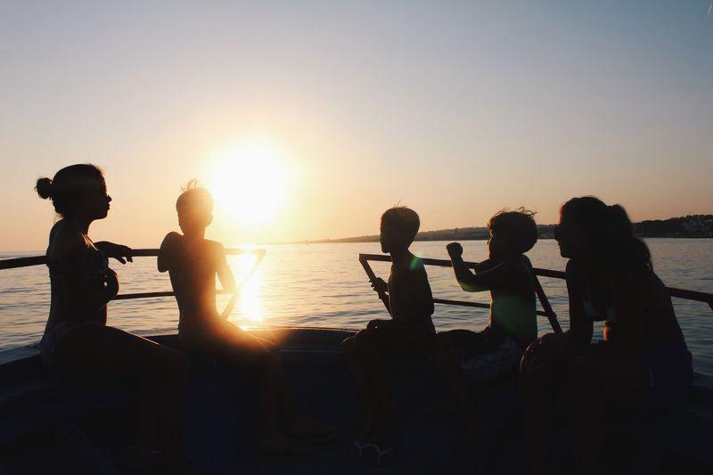 Sea Sunset Sunlight Sun Enjoyment Lifestyles Beauty In Nature Boat Friendship Scenics