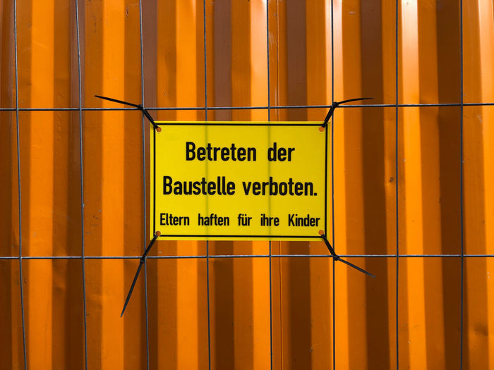 Close-up of warning sign on metal