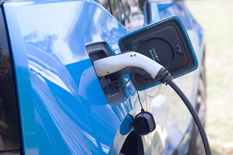 Low angle view of electric car charging