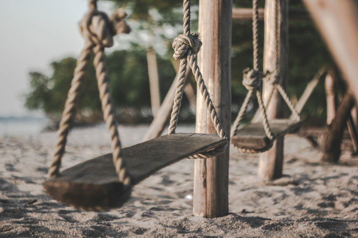 empty playground Rope Swing Hanging Beach Sand Swing Strength Exercising Wood - Material Tree Close-up Outdoor Play Equipment Jungle Gym Coiled Spring Playground Schoolyard Merry-go-round Nuremberg Pulley Slide - Play Equipment Anchor - Vessel Part Slide Chain Seesaw Monkey Bars