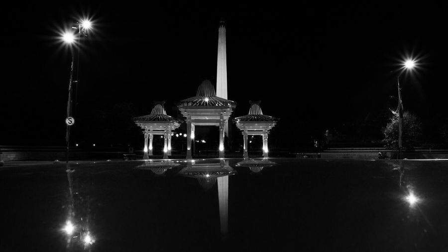 Tugu Pahlawan 1 Surabaya (null)Night Lens Flare Built Structure No People Travel Destinations Architecture Architectural Column Outdoors Reflections Car Historical Building