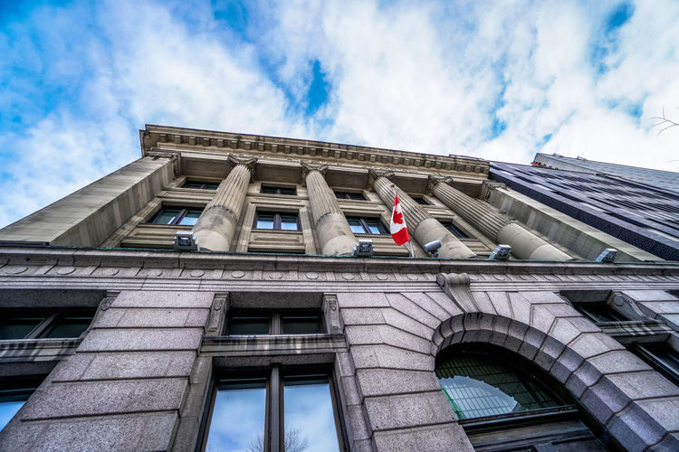 Architectural Column Architecture Architecture Building Exterior Built Structure Canada Canadian Flag City City Gate Cloud - Sky Clouds Day Façade Low Angle View No People Outdoors Sky Sky And Clouds Travel Destinations