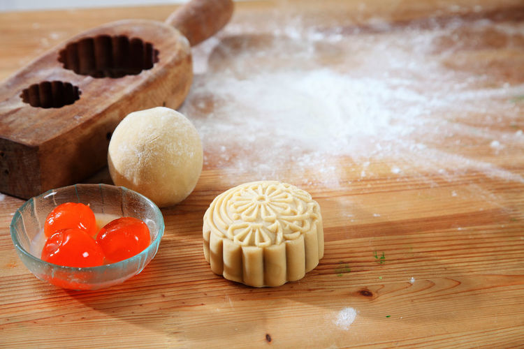 process of the making moon cake for the mid autumn festival Asian  Celebration Dessert Egg Yolk Salted Egg Yolk Baker Bakery Baking Chef Chinese Cultures Egg Gourment Hand Mold Handmade Ingredient Lotus Paste Mid Autumn Festival Moon Cake Mooncake Mould Oriental Traditional