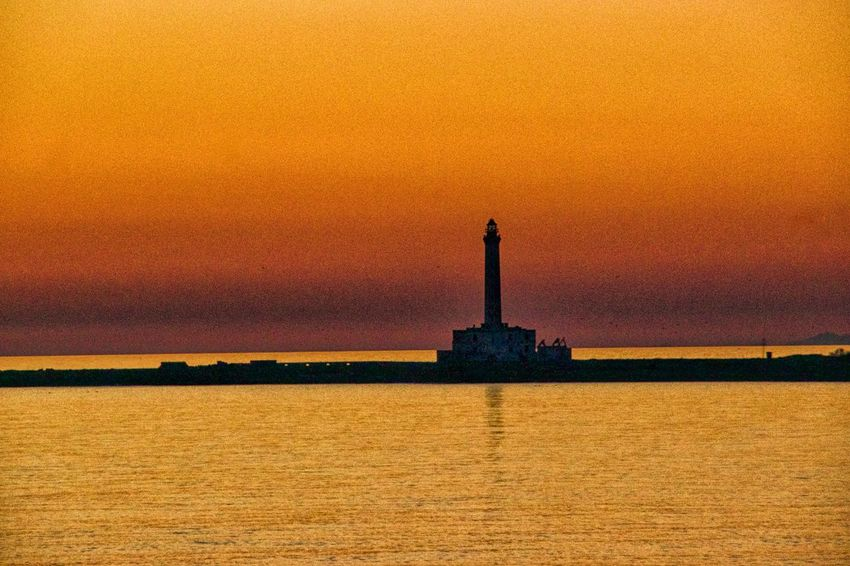Architecture Beauty In Nature Building Exterior Built Structure Day Grainy Horizon Over Water Lighthouse Nature No People Offshore Platform Outdoors Sea Silhouette Sky Statue Sunset Tourism Travel Destinations Water Shades Of Winter
