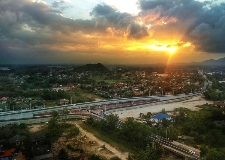 Sunset At Flyover Bukit Tumbuh EyeEmNewHere Terengganuttb Terengganumolek Beautifulterengganu Snappixel Syahrulmohd Skyview Dronephotography Terengganu Visitterengganu Bukitumbuh City Tree Sunset Business Finance And Industry Sunlight High Angle View Dramatic Sky Beauty Car Sun Overpass Elevated Road Countryside Multiple Lane Highway First Eyeem Photo