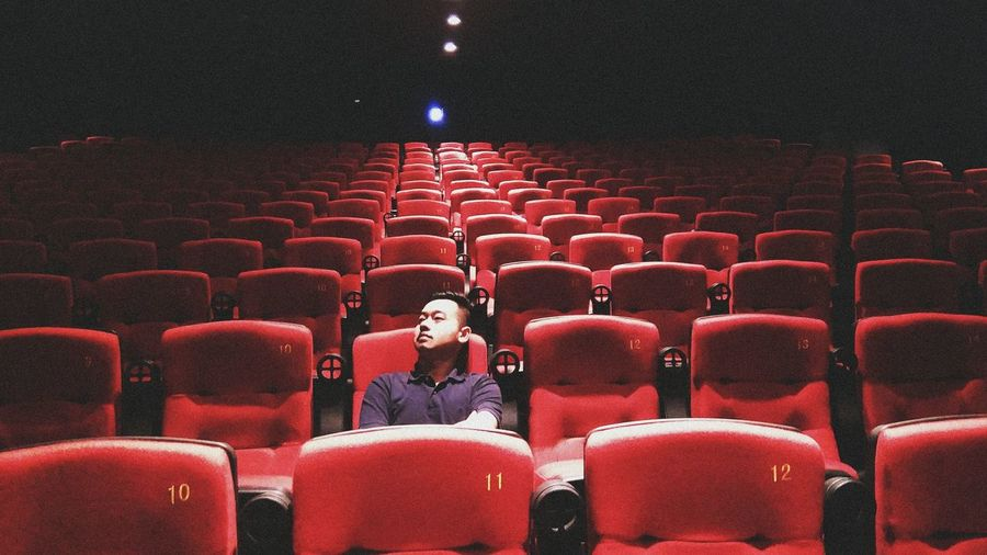 Man sitting in theatre