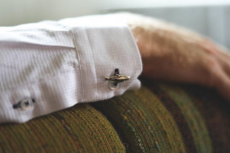 Close-up of cufflink on shirt