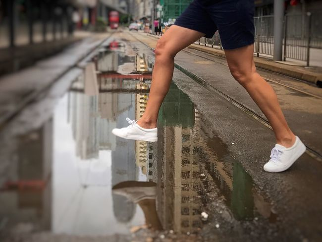 Low Section Human Leg Human Body Part Casual Clothing Jumping Jumping Over Puddle Puddle Wet Outdoors Childhood Lifestyles Day People Built Structure Tram Tracks Urban Lifestyle Streetphotography Street Life