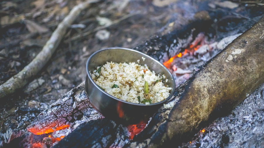 Cooking fried rice on a camp fire Camping Firewood Fire Food Fried Rice Outdoors Nature Close-up Prepared Food Rice - Food Staple