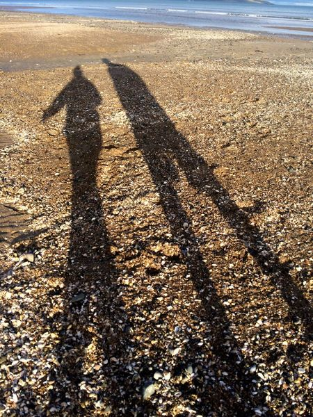 Shadow Focus On Shadow Sunlight Beach Real People Sand Leisure Activity Sea Day Nature Standing Outdoors Lifestyles One Person Water Beauty In Nature Men People