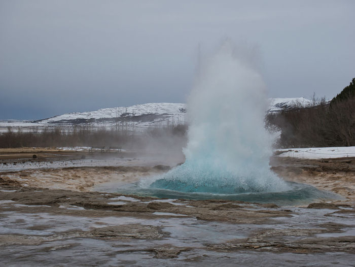 The outbreak of Strokkur Geysir at Golden Circle in winter Geyser Island Clouds Sky Düster Gloomy Cloudy Snow Snowy Snow-covered Winter Fresh Snow Snow Cover Geothermal  Springs Volcanic Option Volcanic  Thermal Steaming Boiling Sulfur  Alkaline Mineral Hot Minerals Bacteria Fountain Fontaene Geysisgil OUTBREAK Strokkur Vent Water Steam Warm Nature Active Activity Smoke Clouds Steam Clouds Power Energy Volcanic Eruption Geothermal Area Ditch Iceland Power In Nature Scenics - Nature Geology Hot Spring