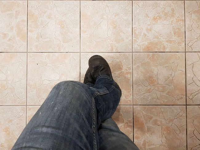 Coffee Time Working Tradesman Boots Worker Break Time! Feet Legs Floor Tiles Low Section One Person Human Body Part Human Leg Shoe People Day Real People Lifestyles Adult One Man Only Men Indoors