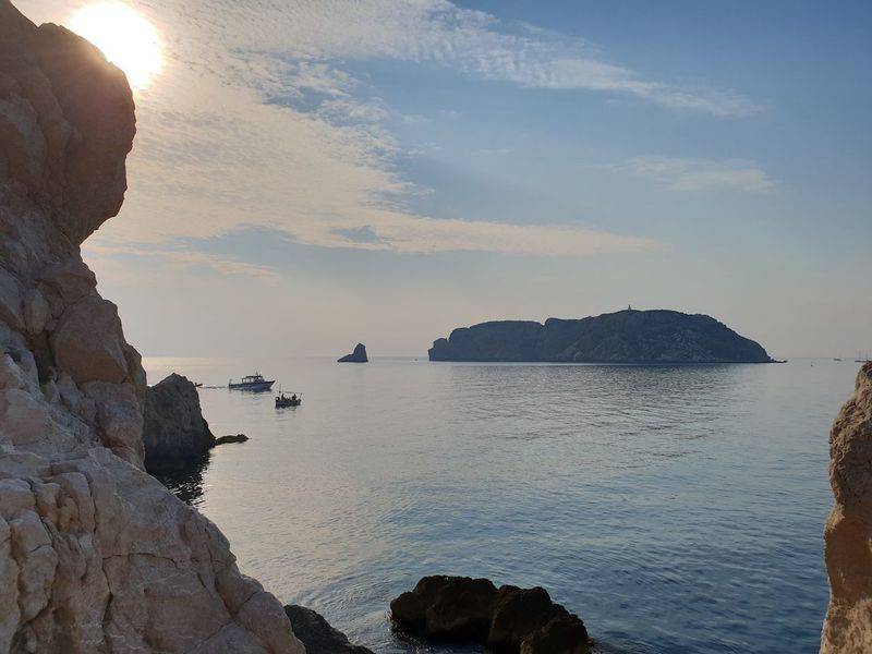 another view is the islands from Rocky mainland. Sea Mountain Sunset Water Silhouette Sunlight City Rock - Object Blue Sun Seascape Rock Formation Rocky Coastline Horizon Over Water Coast