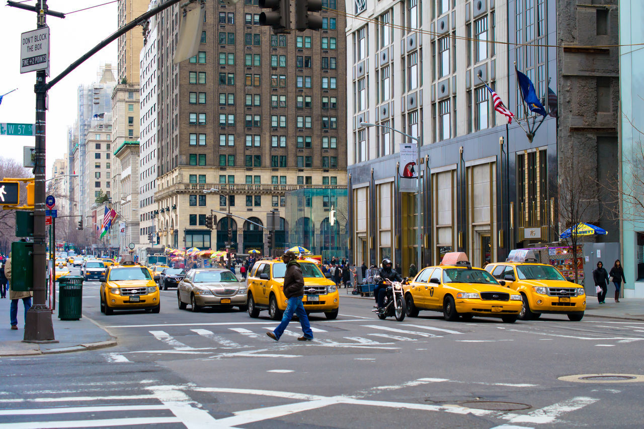 car, city, architecture, street, yellow taxi, taxi, building exterior, traffic, transportation, built structure, city street, city life, land vehicle, outdoors, road, day, people
