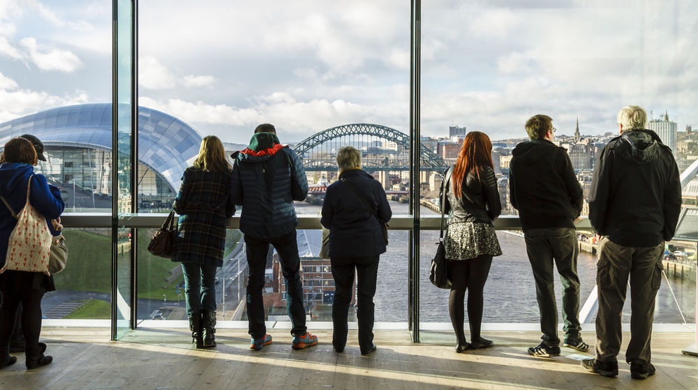People looking out the window of the Baltic Museum at the city view of Newcastle upon Tyne. Casual Clothing City Life Cityscape, Day Group Of People Journey Large Group Of People Leisure Activity Lifestyles Looking, Medium Group Of People Mixed Age Range Newcastle Upon Tyne, Northeast England, People,architecture, Corridors River Tyne, Sky The Sage Gateshead Tourism Tourist Travel Destinations Trip, Excursion, Journey, Tour, Tourist, Visit, Vacation, Get -away, Holiday, Tyne Bridge, Weekend Activities Fresh On Eyeem  Been There.