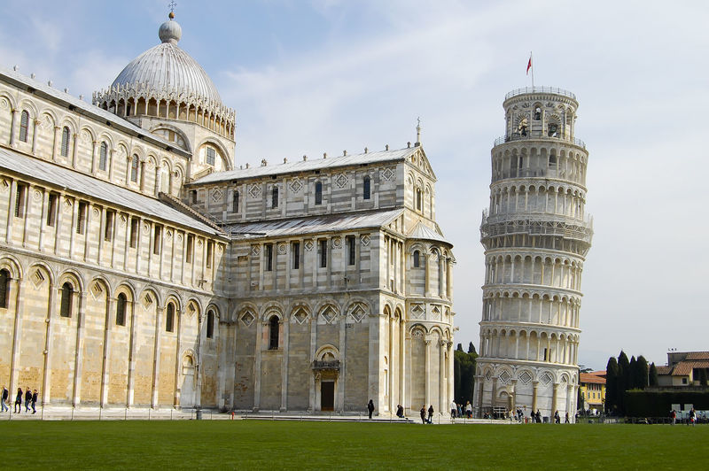 Leaning Tower Of Pisa Against Cloudy Sky