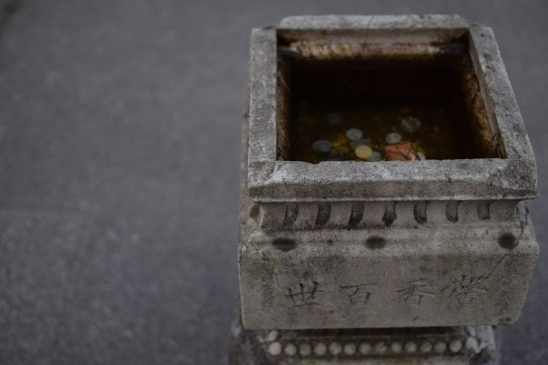 Good fortune Asian  Asian Culture Luck Meditation Nanjing Tranquility Travel Traveling Asiangarden Bassin China Close-up Coins Focus On Foreground Goodfortune Grey Money Stone Temple Temple - Building Tranquil Scene Travel Destinations Water