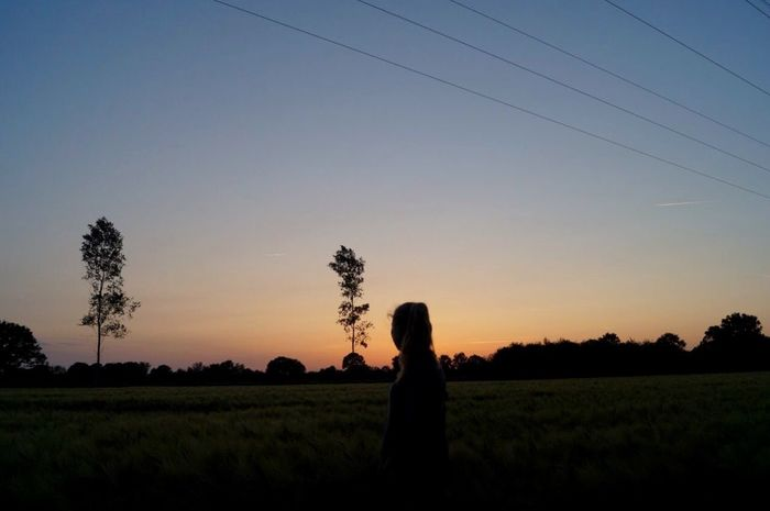 One Person Sunset Field Standing Nature Sky Outdoors Beauty In Nature Landscape