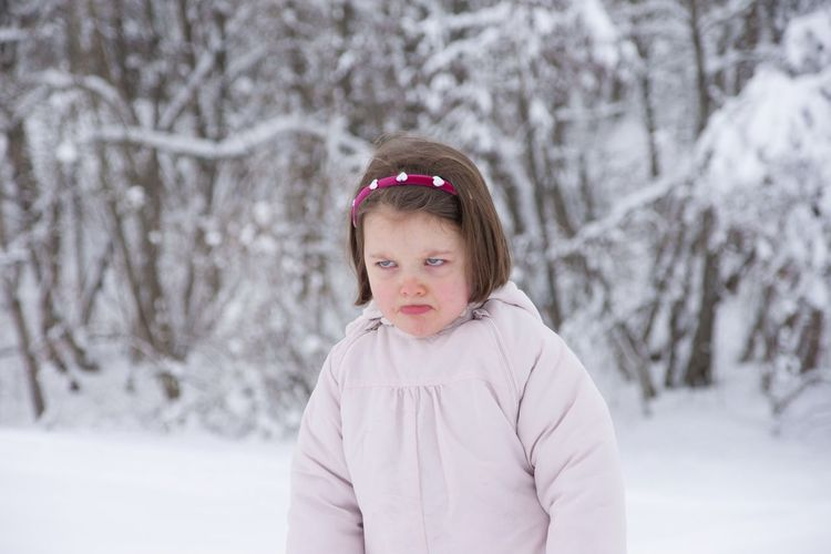 My daughter when young, an other face ! Getty Images Premium Collection Premium Cold Weather Cold Child Grumpy Face Grumpy Winter Snow Cold Temperature Childhood Child Warm Clothing Tree Winter Innocence Portrait Looking