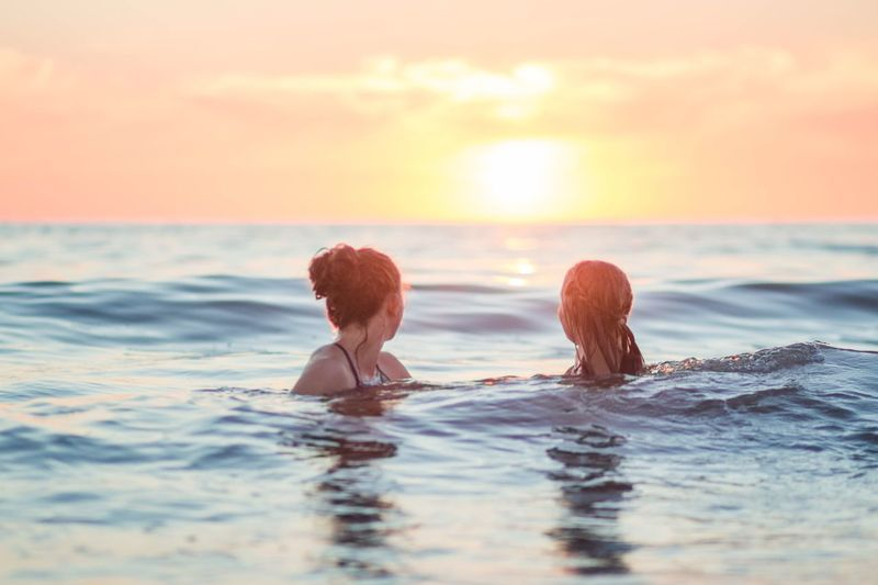 Infinity Girls EyeEm Selects Water Sunset Sky Sea Two People Swimming Holiday Vacations Trip Leisure Activity Women Lifestyles Nature People Horizon Over Water Adult Real People Men Young Adult Outdoors