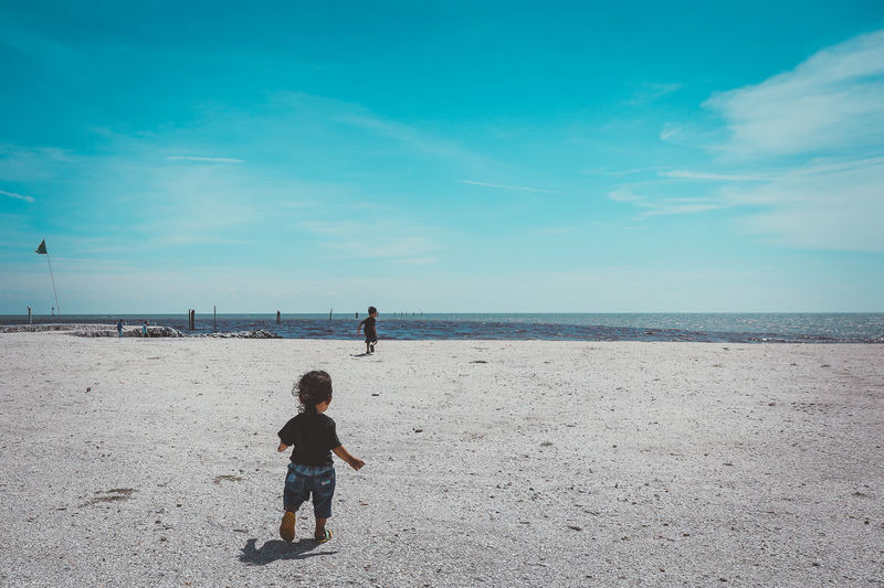 Child running towards his brother on a beach Adult Beach Bonding Child Child Running On Beach Childhood Cloud - Sky Day Family Horizon Over Water Human Body Part Nature Outdoors People Real People Sand Sea Sky Togetherness Two People Vacations Water EyeEmNewHere The Great Outdoors - 2017 EyeEm Awards Neighborhood Map