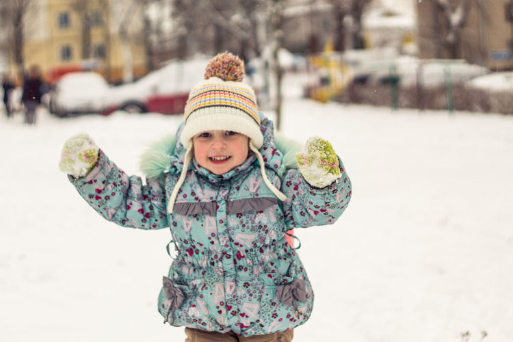 Winter Cold Temperature Child Warm Clothing Childhood Snow Smiling Happiness Clothing Hat Looking At Camera One Person Emotion Females Girls Portrait Real People Cute Innocence Positive Emotion Scarf Outdoors