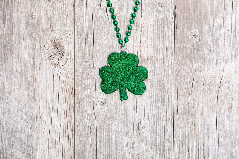 St. Patrick's Day series with lots of copyspace around beads, green beer and pots of gold. Green Holiday Saint Patrick's Day Shamrock St. Patrick's Day St. Patricks Day St. Pattys Day Wood Background Irish No People Poster Background