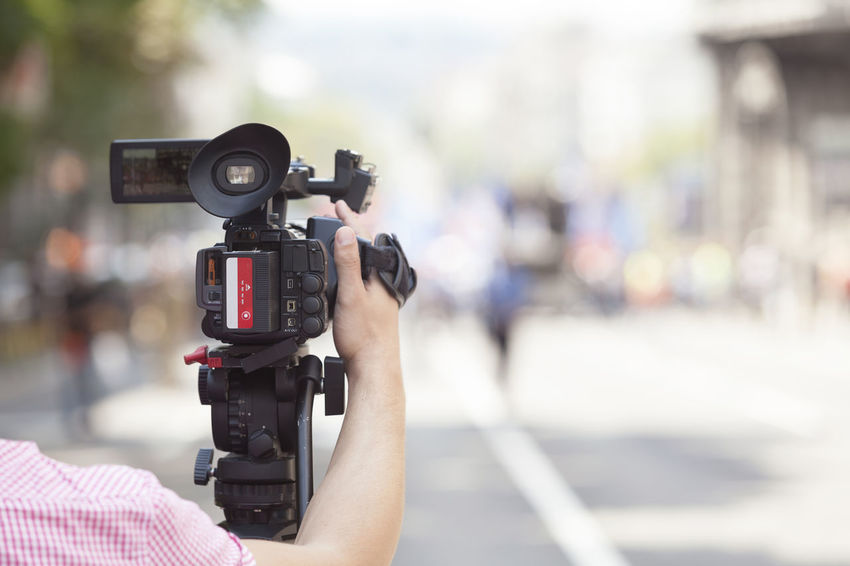 Filming an event with a video camera Adult Adults Only Camera - Photographic Equipment Day Film Film Industry Filming Home Video Camera Human Hand Men MOVIE Movie Camera One Person Outdoors People Photography Themes Professional Occupation Technology Television Camera