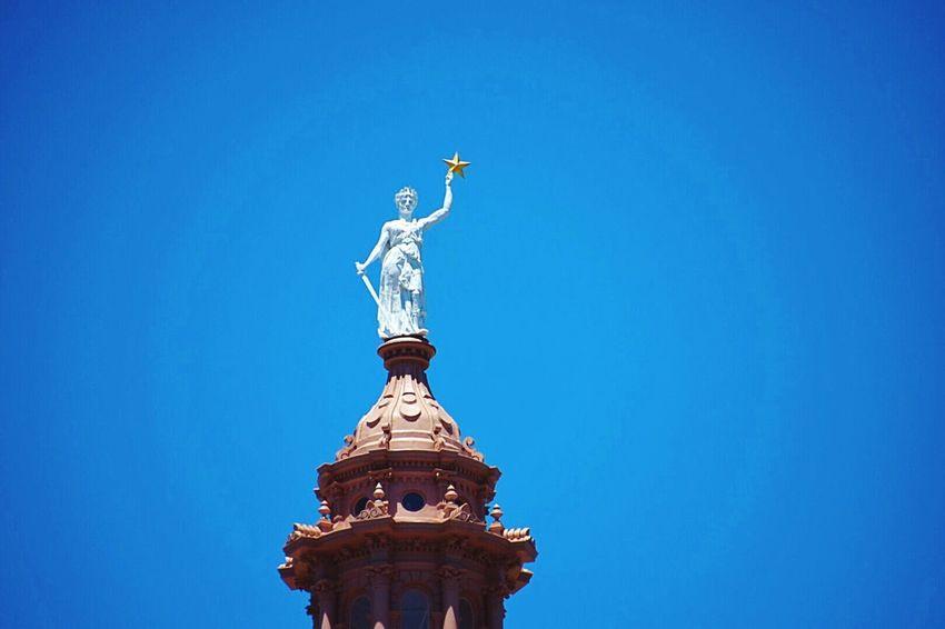 The Architect - 2016 EyeEm Awards Texas Capitol! Capitol Patriotic Goddess Of Liberty Liberty justice Art zinc Sword gold star Torso statue Sky Day Blue Sky