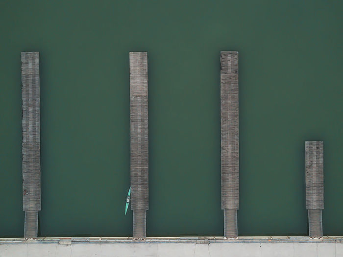 Aerial photo over wooden piers with boat in rowing channel. Plovdiv city, Bulgaria Plovdiv City Bulgaria Europe Aerial View Above Pier Dock Boat Water Lake Rowing Channel Abstract Park Sport Kayak Kayaking Kanu Architecture Art Green Composition
