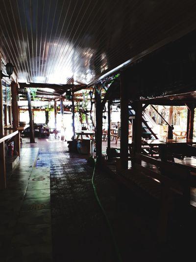 Empty walkway in illuminated building
