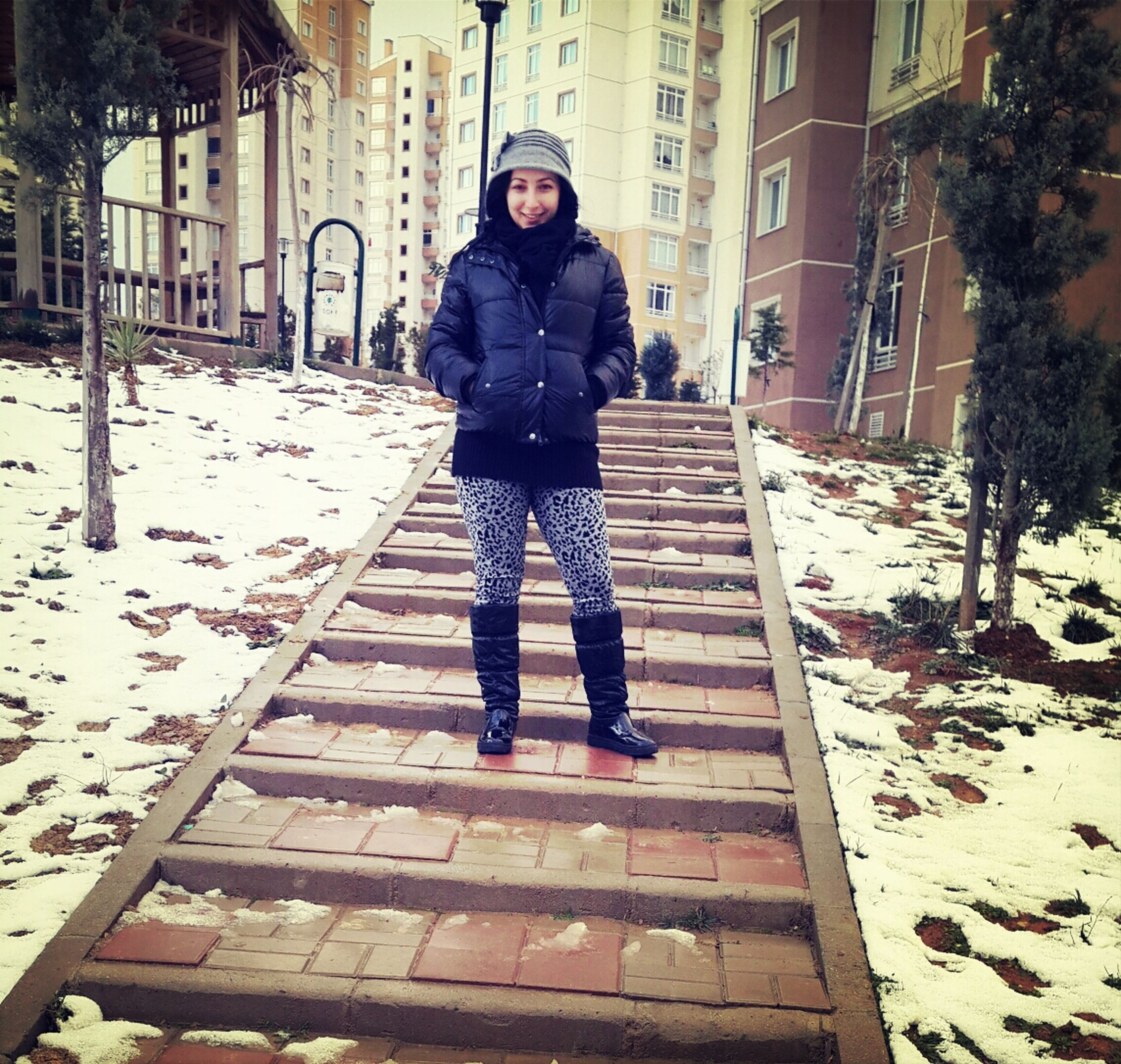 full length, snow, winter, lifestyles, building exterior, built structure, architecture, cold temperature, season, warm clothing, standing, casual clothing, leisure activity, walking, front view, young adult, rear view, steps
