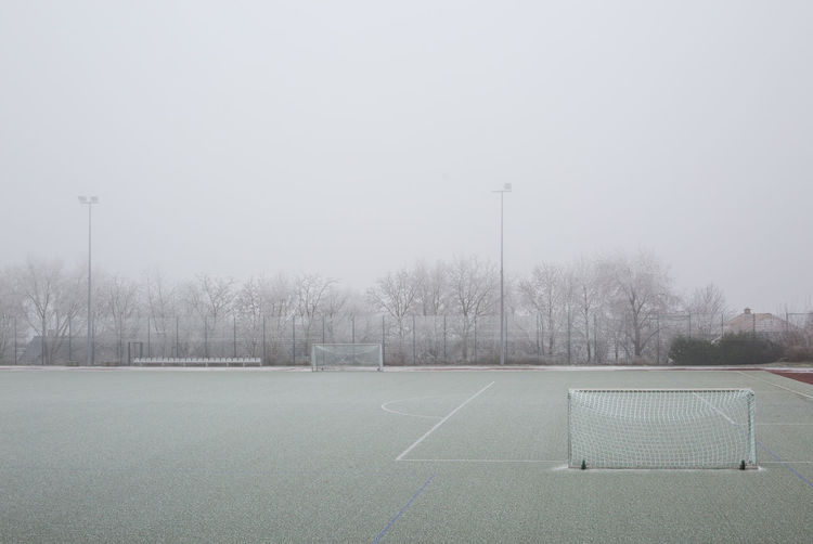 View of soccer field against sky during foggy weather