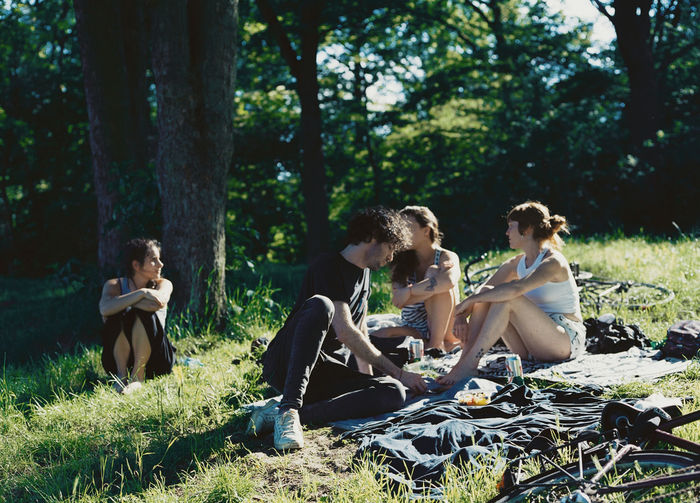 Group of people sitting on grassland