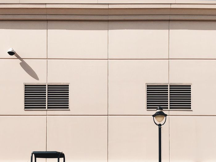 No People Architecture Building Exterior Built Structure Day Lines Wall Industrial Warehouse Shadow Background Backgrounds Lamp Post Pattern Wall - Building Feature Copy Space Building Sparse