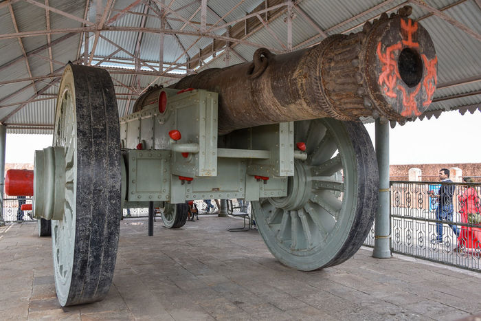 WORLD'S LARGEST CANON : The Jaivana Cannon was only fired once by the Jai Singh II. Most sources, including local tourist guides agree that it was fired in the direction of Chaksu. The impact is said by many locals and tourist guides to be powerful enough to have caused a depression where a pond can be seen today. Legend also says that when it was about to be shot, it was kept near a water tank. It was kept there for the gunner to dive in and escape the shock waves. But during the shot, he and eight other soldiers along with one elephant were reportedly killed due to the shockwaves. Many small houses in Jaipur collapsed as well. Jaigrah Fort Jaivana Cannon Cannon Cannonball Cannon Wepon Ammunition Weapon Weapons Weaponsofwar Metal Metallic Man Made Object Army Old Weapon Old-fashioned Military Canon Wepon Place To Visit In Jaipur Historical Building Places You Must To See Travelling Vacations No People Built Structure Monument Be. Ready.
