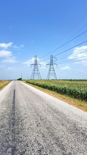 Corn Fields in Texas Rural Scene Road Technology Sky Cloud - Sky Electricity Tower Power Line  Electricity  Power Supply Empty Road Power Cable Electric Pole vanishing point Electrical Grid