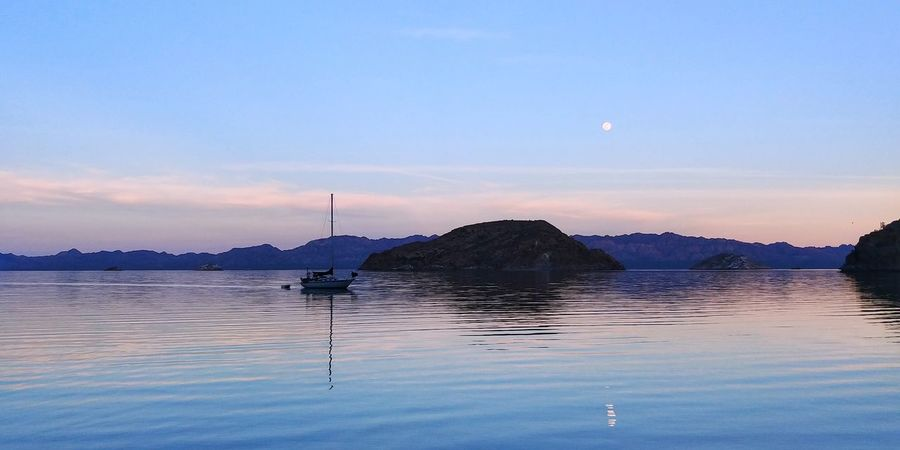 coyote Boat Boats Wather Reflections Wather Travel Destinations Clouds And Sky Landscape_Collection Clouds Travel Landscape_photography Moon Water Blue Tranquility Sea Beauty In Nature Outdoors Landscape Swimming No People Mountain Astronomy Sunset Clear Sky