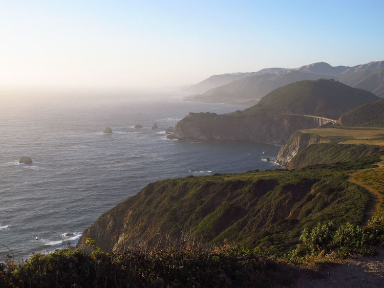 Distance View Dreaming Highway 1 Beach Beauty In Nature Big Sur Clear Sky Day Grass Horizon Over Water Landscape Mountain Nature No People Outdoors Scenery Scenics Sea Sky Sunset Tranquil Scene Tranquility Water