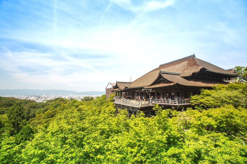 Kiyomizu-Dera And Trees Against Cloudy Sky