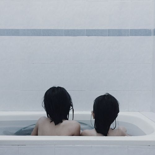 Two People Leisure Activity Real People Headshot Rear View Indoors  Lifestyles Togetherness Taking A Bath Young Women Women Young Adult Childhood Water Day People Bathroom Bathtub Sister Neon Life EyeEm Selects EyeEmNewHere Breathing Space Mix Yourself A Good Time The Week On EyeEm