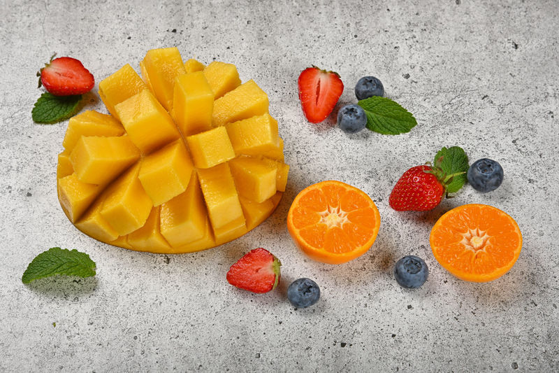 Close up fresh fruits on stone cutting board to prepare smoothie Fruit Food Food And Drink Healthy Eating Freshness Berry Fruit Wellbeing No People Strawberry SLICE Still Life Directly Above Chopped Close-up Orange Color Multi Colored Mango Fruit Large Group Of Objects Sweet Food Ripe Orange Snack Mint Leaf - Culinary Mint Leaves Blueberry Halved Orange - Fruit Tangerine Clementine Mandarin Oranges Citrus Fruit Preparing Food Vitamins