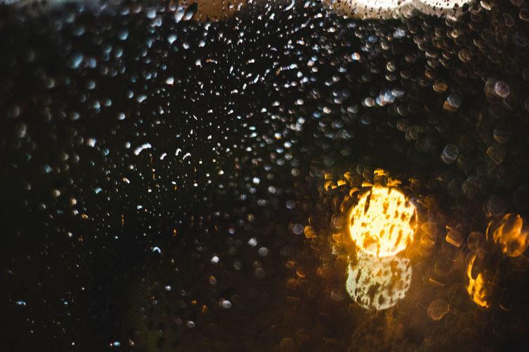 No People Night Illuminated Glowing Close-up Lighting Equipment Backgrounds Motion Outdoors Full Frame Yellow Water Nature Orange Color Christmas Light - Natural Phenomenon Dark Light Bokeh Rain Window Winter Lights RainDrop Wallpaper