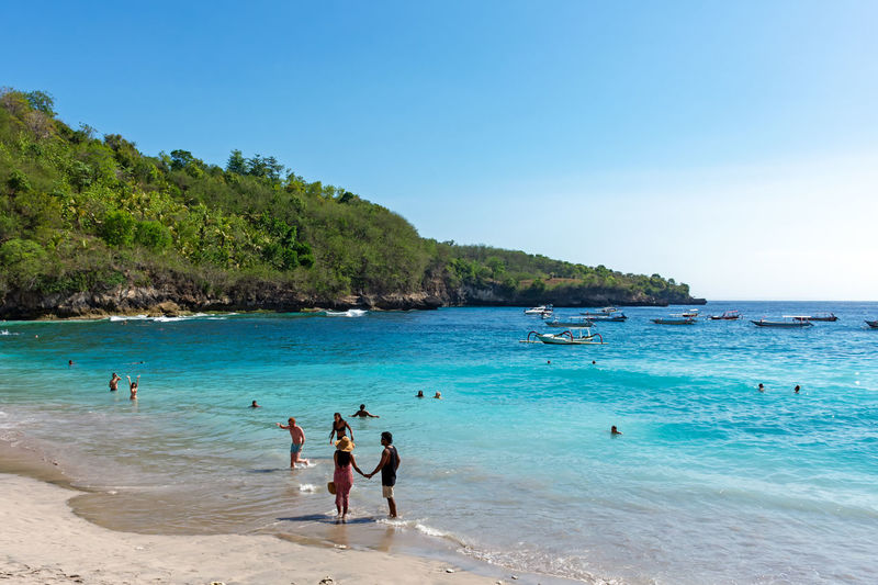 Nusa Penida Crystal Bay Water Sea Beach Sky Land Leisure Activity Beauty In Nature Scenics - Nature Group Of People Trip Vacations Nature Lifestyles Holiday Real People Blue Day Clear Sky Women Horizon Over Water Outdoors Turquoise Colored Bali INDONESIA