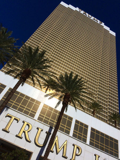 Las Vegas, NV, USA – November 13, 2016: Exterior shot of the Trump International Hotel in Las Vegas. Golden Las Vegas Trump Hotel Architecture Building Building Exterior Built Structure City Clear Sky Day Hotel Low Angle View Modern Nature No People Outdoors Palm Tree Pattern Plant Sky Sunlight Tree Tropical Climate Trump Window