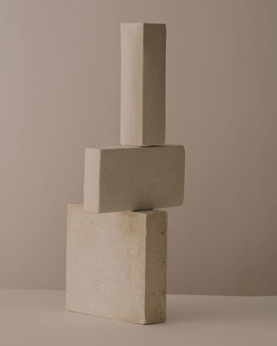 Close-up of stone stack on table against white background