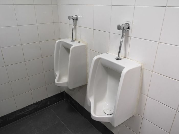 High Angle View Of Urinal In Bathroom