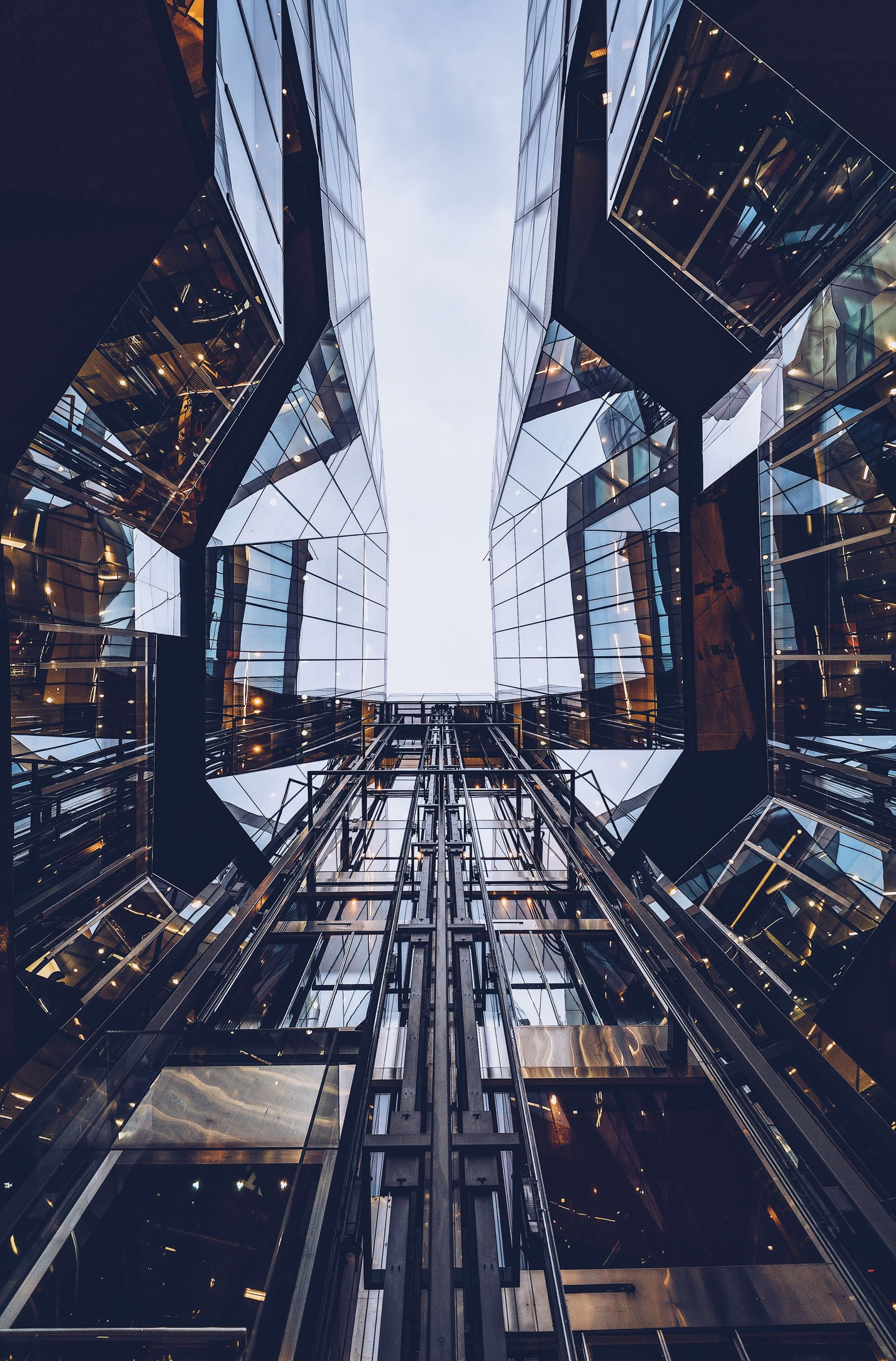 architecture, built structure, sky, building exterior, low angle view, no people, building, tall - high, nature, modern, city, day, metal, office building exterior, outdoors, transportation, railing, skyscraper, the way forward, glass - material, directly below
