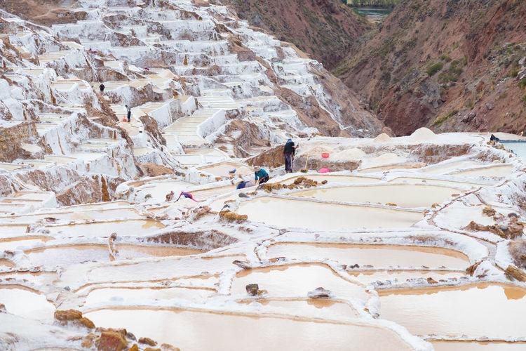 High angle view of people on salt ponds