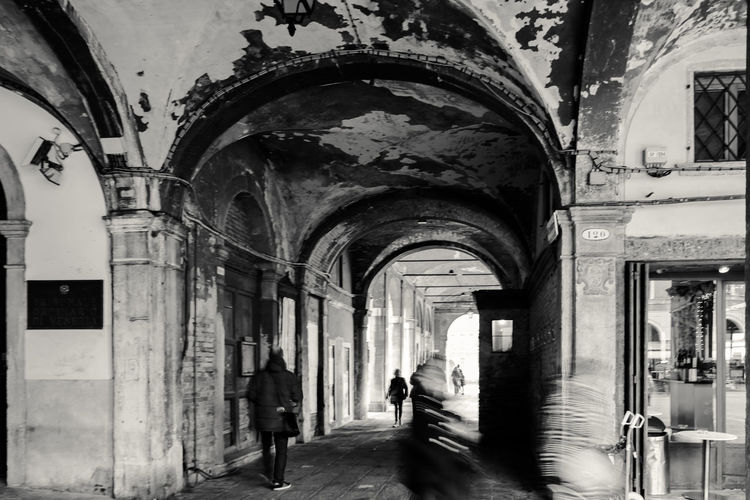 Venice Streets Arcade Arch Arched Architectural Column Architecture Blurred Motion Building Building Exterior Built Structure City Day Group Of People History Incidental People Men Motion Outdoors People Real People The Past The Way Forward Walking Women